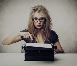An image of a woman doing some content writing on TheWordsFactory Content Writing Services page.